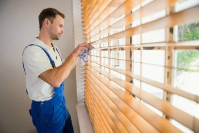 Two-Hour Minimum, Man Cleaning Blinds