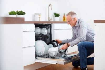 Airbnb Guests Clean Up, Man Loading Dishwasher