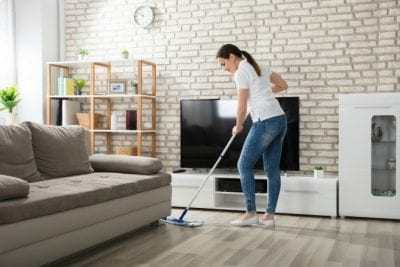 Hardwood Floor Secrets, Woman With Dustmop Cleaning Wood Floor