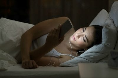 The Fear of Rejection, Woman Earbuds Cell Phone Going to Sleep