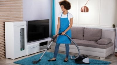 Who Does the Daily Chores housecleaner vacuuming carpet