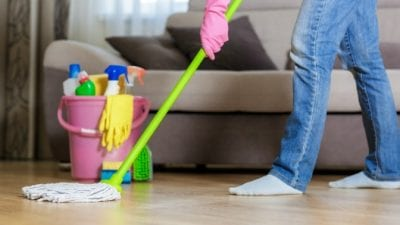 Who Does the Daily Chores man mopping the floor in living room