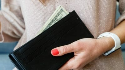 Who Does the Daily Chores woman holding wallet with cash
