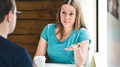 Fire the Maid by Text serious woman explaining something