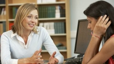 Fire the Maid by Text teacher talking to unhappy student in office