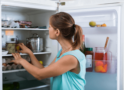 Angela Brown's Top 10 Holiday Cleaning Tips, Woman Looking in Refrigerator