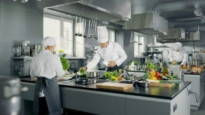 Rebuild Your Cleaning Business chefs cooking in big restaurant kitchen