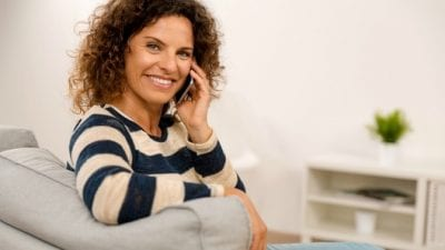 Rebuild Your Cleaning Business woman at home making phone call