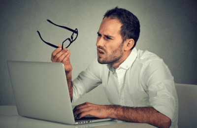Amazon Home Services to Grow My Cleaning Company, Confused Man with Glasses Looking at Computer