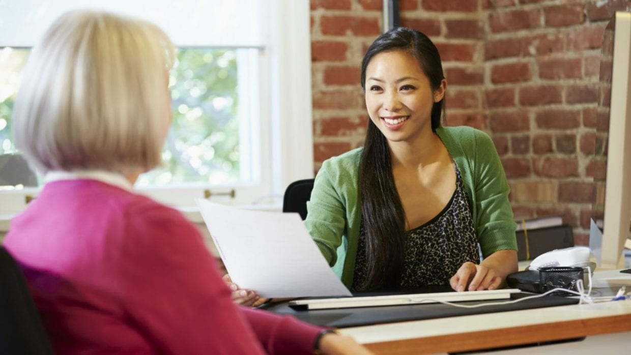 How to Ask for a Raise - Two women in an interview -Featured Image