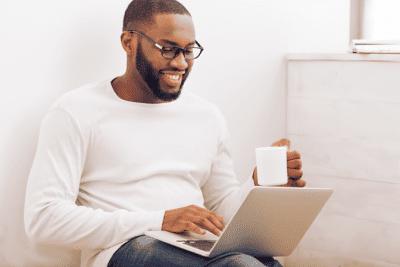 Employee Handbook Guide, Man Working on Laptop