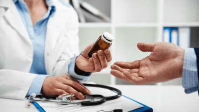 Feel Unsafe While Cleaning doctor handing patient prescription