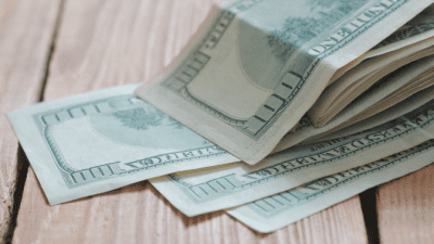 Feel Unsafe While Cleaning stack of money on table
