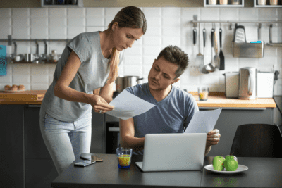 Worksheet Overkill, Man and Woman Reading Letter at Home