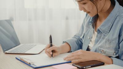 Worksheet Overkill, Woman Working on Checklist