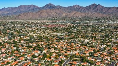 Family Competition thousands of homes in suburbs, mountain background