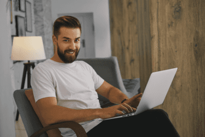 In Business With Your Spouse, Happy Man on his Computer