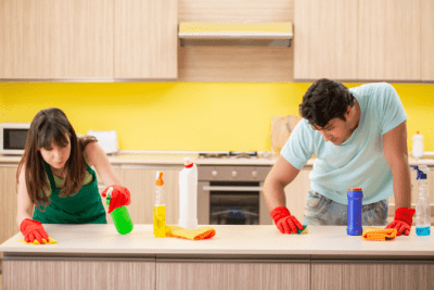 In Business With Your Spouse, Man and Woman Cleaning Kitchen