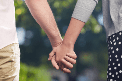 In Business With Your Spouse, Woman and Man Holding Hands