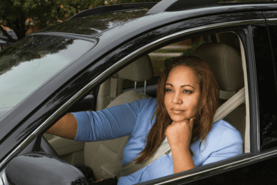 Appointment Reminders, Woman Thinking in Car