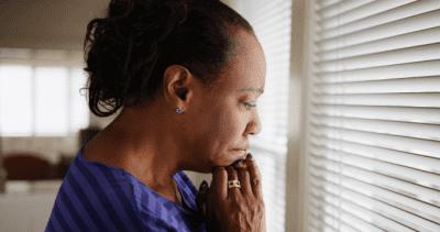 Hoarding Jobs, Sad Woman Looking Out Window