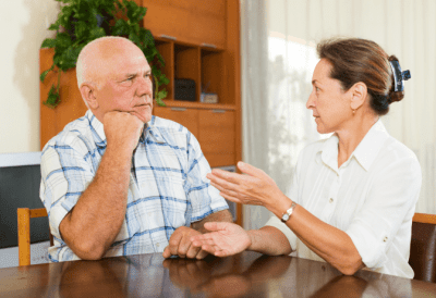 Hoarding Jobs, Woman Having Conversation with Man