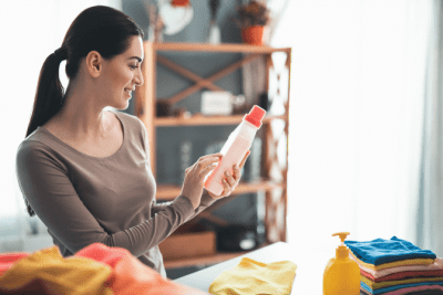 SDS Safety Data Sheets, Woman Reading a Product Bottle