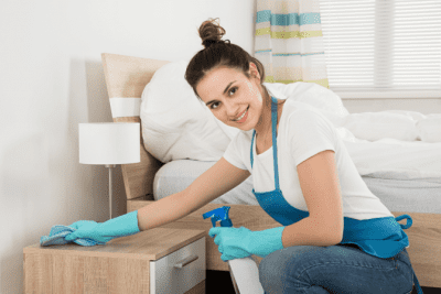 Charge by the Room, House Cleaner Wiping Bedroom Nightstand