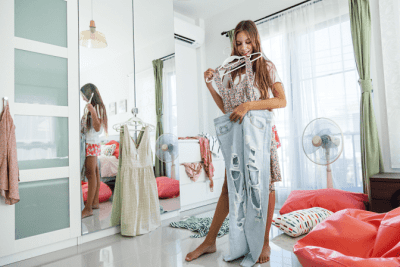 Charge by the Room, Teen Looking at Clothes in Messy Bedroom
