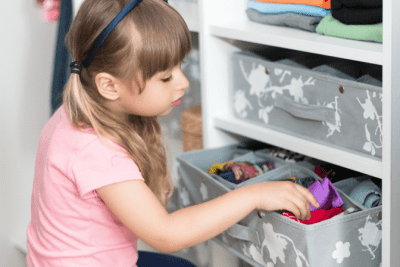 Clean Around Lived In, Child Putting Away Clothes