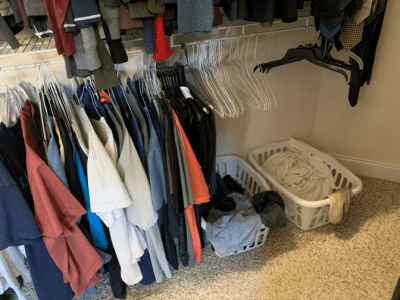 Clean Around Lived In, Laundry Baskets and Clothes in Closet