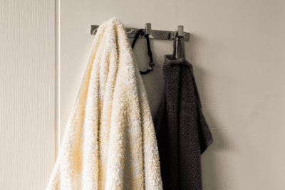 Clean Around Lived In, Towels Hanging to Dry