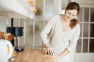 Cleaning Relaxes Me Should I Start a Business, Woman Cleaning Kitchen Counter