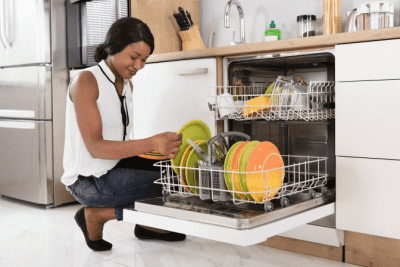 Compliments and Complaints, Woman Loading Dishwasher