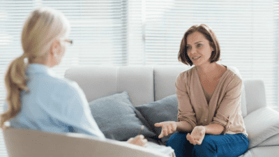Can Hoarders Be Cured woman talking to therapist at home