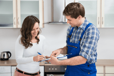 Advertising for Your House Cleaning Business, Woman Signing Handyman's Invoice
