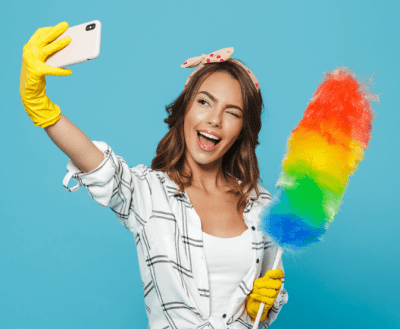 Advertising for Your House Cleaning Business, Woman with Cleaning Supplies Taking Selfie