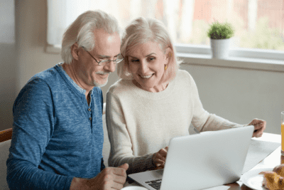 Booking Software - Is That a Firm Price or an Estimate, Woman and Man on Computer