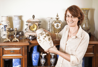 Fragile Collections, Woman Holding Antique Vase