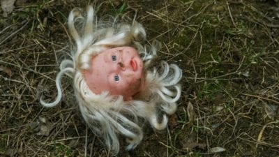 Permission to Toss, broken doll