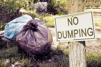 Trash in Other People's Dumpsters, No Dumping Sign With Trash Bags
