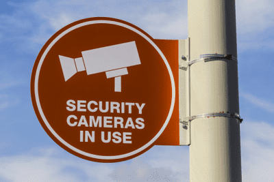 Trash in Other People's Dumpsters, Security Camera Sign