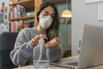 Advertise Without Scare Tactics, Woman Wears Mask Using Hand Sanitizer