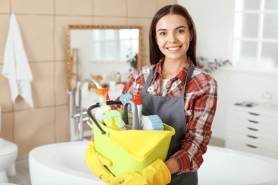 Can I Sue My Cleaning Company, Woman Holding Cleaning Supplies