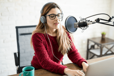 Should Your Cleaning Buisness Have a Podcast, Woman Talking into Microphone