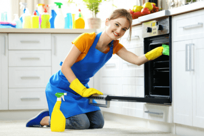 Employees or Contractors, Woman Cleaning Oven