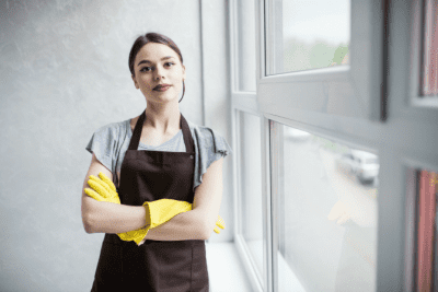 Keep Employees From Stealing Your Clients, Annoyed House Cleaner with Arms Crossed