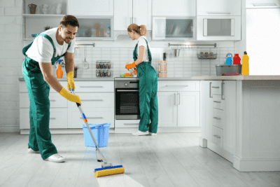 Spend Annually on Cleaning Supplies, Two House Cleaners in Kitchen