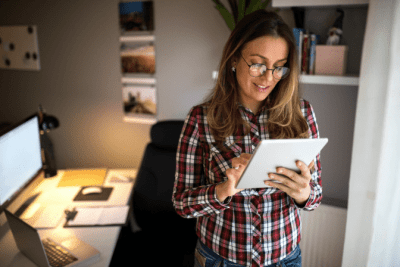 Time Slots for Cleaning Accounts, Woman Looking at Tablet in Office
