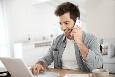 Are Credentials Worth Paying For, Man Talking on Phone Using Computer